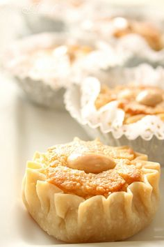 Dziriettes are traditional Algerian cookies. They are little tarts filled with almonds and once baked they are plunged in an orange blossom syrup.