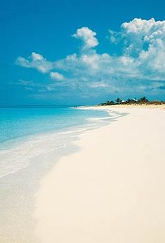 Recipe for relaxation:   - one part unspoiled sandy beach  - two parts clear turquoise water  - topped with miles of blue sky