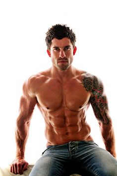 tattoos + men adds that oomph  i dont know what i notice first. the 8-pack, face or tattoo