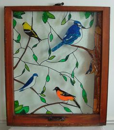 Stain glass painting on old window frame.