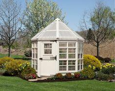 gewächshaus bauen achteckig-design-vintage-stil-klein-buesche-bluehen