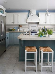 Light and Bright  This kitchen has plenty of space, an efficient layout, and a color scheme of cool blues and crisp whites to create an updated, classic look.