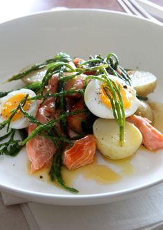 Hot-smoked freshwater or ocean trout needs only a quick warm-up in the oven; otherwise use fresh salmon or ocean trout cooked until pink inside. 8 small new potatoes, unpeeled 200g samphire, rinsed 4 soft-boiled (e.g. 3 minutes) eggs 500g hot-smoked trout 2 tbsp flat-parsley leaves Dressing 2 tbsp lemon juice 3 tbsp extra virgin olive oil 2 tsp Dijon mustard sea salt and pepper