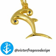 14k yellow gold and sapphire cabochons in the eyes, make this hammerhead shark silhouette a simple yet unique pendant!