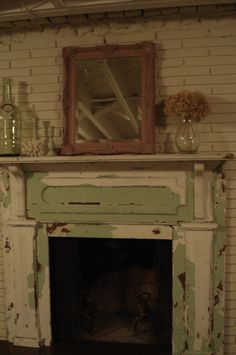 Shabby Green Mantel With a Shabby Mirror. Funny -- I like the shabbiness of the fireplace and mantle, but would have to mix it with something cleans and fresh and modern looking, like nice, clean, freshly painted walls ...and lots of sunlight, of course!