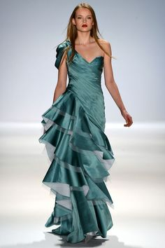 Carlos Miele. A pretty architectural skirt gives full dimension to a satin evening gown.