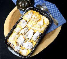 Topfenpalatschinken, mit Quark gefüllte, überbackene Pfannkuchen.
