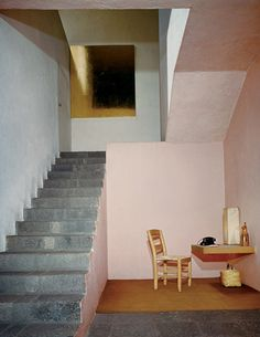 This shows us just how much colour can change a space. The pink instantly softens the lines of concrete.