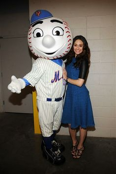Modest electric blue dress, short leather sleevs and knee length. Emmy Rossum poses for a photo with Mr. Met before singing the national anthem at the New York Mets opening day at Citi Field in Queens, New ...