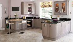 Con solo una table redonda puede aprovecharse una esquina en la cocina.