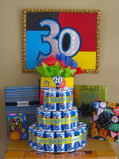 """Miller Lite Cake - I am by NO MEANS promoting drinking, but this is a clever way to serve a non-dessert-eating husband """"cake"""" on his 30th. Also great for a 21st!"""