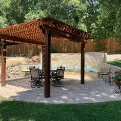 Pergola and paver patio with stone seating bench Landscaping Company, Arbors, Bench, Outdoor Structures, Landscape, Stone, Courtyards, Scenery, Rock