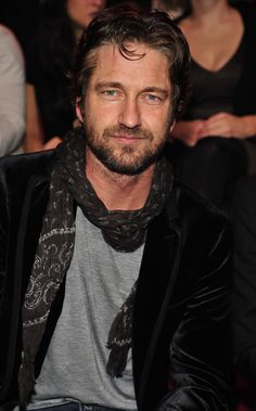 Pin for Later: 150+ Supersexy Moments to Get You Excited For the VS Fashion Show  Gerard Butler had a great view of the models during the 2010 show.