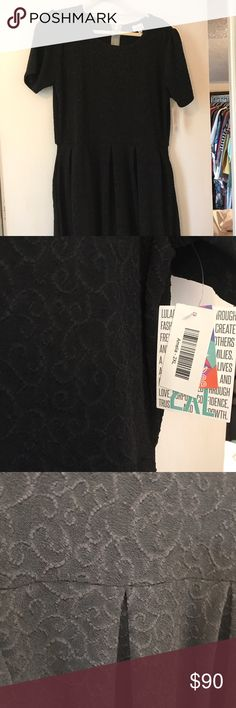 HTF BLACK BNWT lularoe 2x Amelia dress - pockets! HTF BLACK BNWT lularoe 2x Amelia dress - pockets! Black textured background with scroll swirls. Zipper in back and pretty stretchy material LuLaRoe Dresses Midi