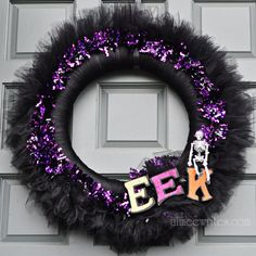 Tulle Halloween wreath- Could be a cute Christmas wreath with the tinsel