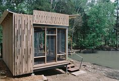 "For the Knoxville-based CEO of environmentally-focused marketing firm the Shelton Group, building an off-the-grid lakefront pavilion in Sharps Chapel, Tennessee, wasn't so simple. With the help of architect Brandon Pace, she built a small prefabricated cabin on a ""funky piece of property"" on Norris Lake, a man-made reservoir."