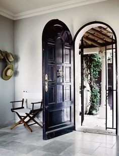 glossy, arched black door
