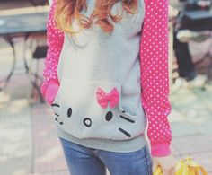 Gray hoodie with Hello Kittie pouch and pink polka dot sleeves. Perfect for Harajuku!