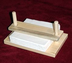 Wooden napkin holder press.