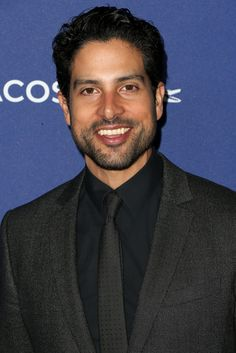Adam Rodriguez Photos Photos - Actor Adam Rodriguez attends the 18th Costume Designers Guild Awards with Presenting Sponsor LACOSTE at The Beverly Hilton Hotel on February 23, 2016 in Beverly Hills, California. - 18th Costume Designers Guild Awards - Arrivals And Red Carpet