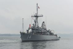 SASEBO, Japan (July 3, 2014) The Avenger-class mine countermeasure ship USS Chief (MCM 14) enters port after exiting an ocean-going heavy lift ship with USS Pioneer (MCM 9). Chief and Pioneer will replace USS Avenger (MCM 1) and USS Defender (MCM 2) and be forward deployed to Commander Fleet Activities Sasebo, Japan. (U.S. Navy photo by Mass Communication Specialist Seaman Apprentice Patrick Dionne/Released)