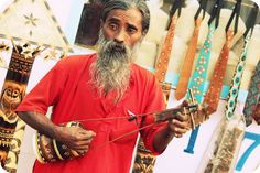 A baul selling the Iktaras (one-stringed instruments) —maybe he could teach me a thing or two about how to string and play it!    #ridecolorfully