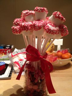 Marshmallow treats with red sprinkles. *these would be good for a Valentines gift or Christmas goodie.
