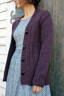 This sweater is a classic cardigan with interesting lines at the shoulder and a beautifully delicate cable pattern on the body.