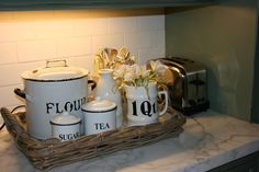 vignette design: Getting Organized in the Kitchen - maybe do this with my seagrass tray and majolica canisters