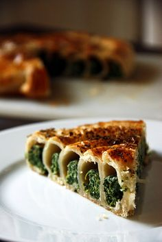 Spinach spiral with puff pastry.  Cut puff pastry into four equal strips lengthwise, layer with a pound of frozen spinach and 1 cup ricotta cheese (and a handfull of raisins if no complainers)shape into tubes longways, then spiral around. Cover with egg wash and bake 30 minutes at 350