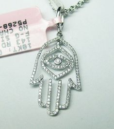 Auction: 0.23CT F SI 18K WHITE GOLD MICRO PAVE DIAMOND HAMSA PENDANT (eBay Link)