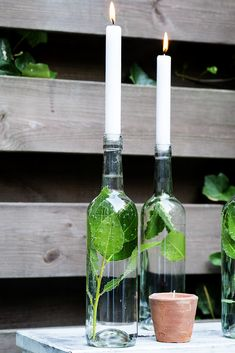 15 Wine Bottle Decor Ideas Easy With A Touch Of Magic wine bottle crafts 15 Wine Bottle Decor Ideas – Easy With A Touch Of Magic – PolyTrendy Empty Glass Bottles, Wine Bottle Centerpieces, Wine Bottle Candles, Wine Bottle Decorations, Diy Bottle, Wine Bottle Crafts, Bottle Art, Pot Mason Diy, Mason Jar Crafts