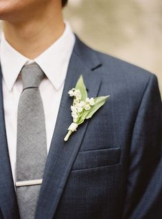 Wedding Ideas: groom-navy-j-crew-suit-gray-tie-bar-clip-lily-of-the-valley-bout