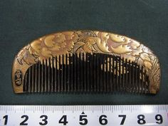 Early Meiji Period comb with peony design in lacquer.