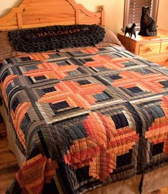 The Log Cabin--all dressed up for Halloween! From the eBook Modern Primitive Quilts by Laurie Simpson.