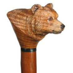 Hand carved wildlife walking stick, walking cane and hiking sticks in wildlife designs by Ivan Wilson of Wilson Staffs