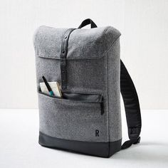 NEW! Modern, minimal and made to last. Crafted of sturdy wool, the slim Hex Tweed Cloak Backpack is smart and stylish. With a padded pocket and an interior organizer, it's perfect for transporting your laptop, tablet or other tech.