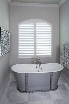 White Hunter Douglas Heritance shutters in master bath