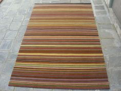 Love this coloured striped rug