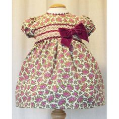 Divine little girl's dress in purple and cream with purple velvet bow.  Size 18 - 24 months.  www.violetagnes.co.uk