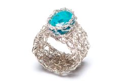 Handmade sterling silver ring in knitted mesh with turquoise stone.  http://www.pennylevi.com/