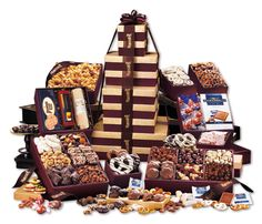 Our largest tower ever! 22 gourmet treats packed into nine rich burgundy and gold gift boxes (yes, they are reusable). Serves 50 people or more! They'll know you've sent the biggest and the best from the moment it arrives. Gourmet Food Gifts, Gourmet Gift Baskets, Gourmet Recipes, Corporate Gift Baskets, Corporate Gifts, Ghirardelli Chocolate Squares, Promo Gifts, Themed Gift Baskets, Gold Gift Boxes