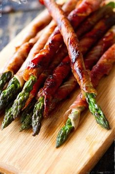 Get ahead of the game. Roll asparagus in prosciutto (or thinly-sliced bacon) a few hours before, and then pop the spears in a frying pan just before dinner time. Perfect for Christmas....or for right now. Click through for more Christmas appetizers.