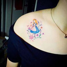 Alice in Wonderland piece done by @h.suantsai #inkeddisney tattoo