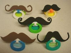 Mustache pacifiers.