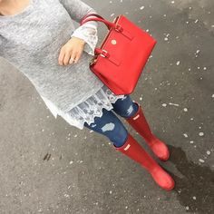 Rainy day outfit wearing red Hunter boots, distressed jeans and lace hem sweater! Via @glamourzine
