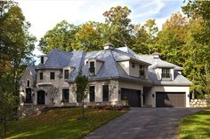 This house is way too big. But I really like how the 4 car garage is split into 2