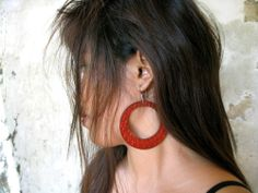 Ready to party with Anna Sukardi's large embossed leather hoops.