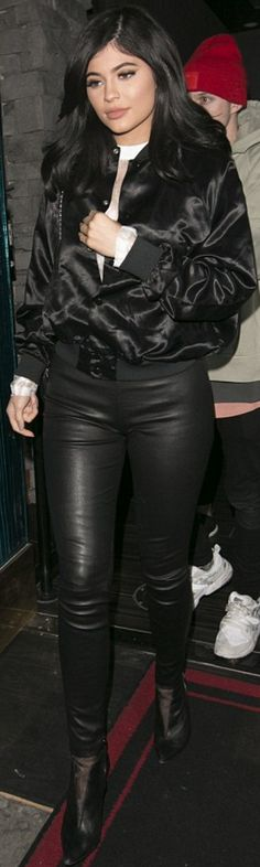 Who made  Kylie Jenner's mesh ankle boots, black leather pants, satin jacket, and quilted handbag?