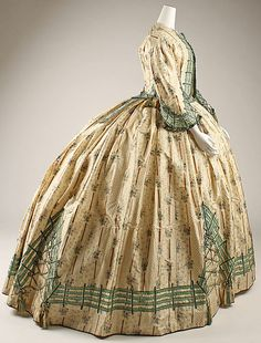 Dress Date: ca. 1862 Culture: French Medium: silk Dimensions: Length at CB (bolero): 19 in. (48.3 cm) Length at CF (skirt and bodice): 55 1/...